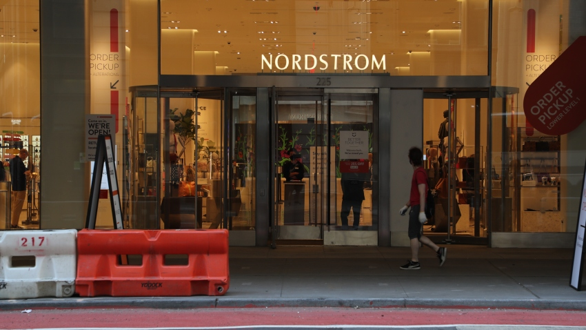 A person walks by Nordstrom flagship store in Midtown Manhattan as New York City moves into Phase 3 of re-opening following restrictions imposed to curb the coronavirus pandemic on July 13, 2020.