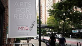 NEW YORK, NEW YORK- AUGUST 31: People walk past an apartments for rent sign in New York City.