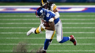Terrell Edmunds #34 of the Pittsburgh Steelers tackles Levine Toilolo #85 of the New York Giants during the second half at MetLife Stadium on September 14, 2020 in East Rutherford, New Jersey.
