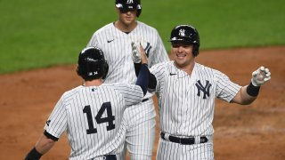 Luke Voit #59 of the New York Yankees celebrates with Tyler Wade #14 after hitting a three-run home run during the second inning against the Toronto Blue Jays at Yankee Stadium on September 15, 2020.