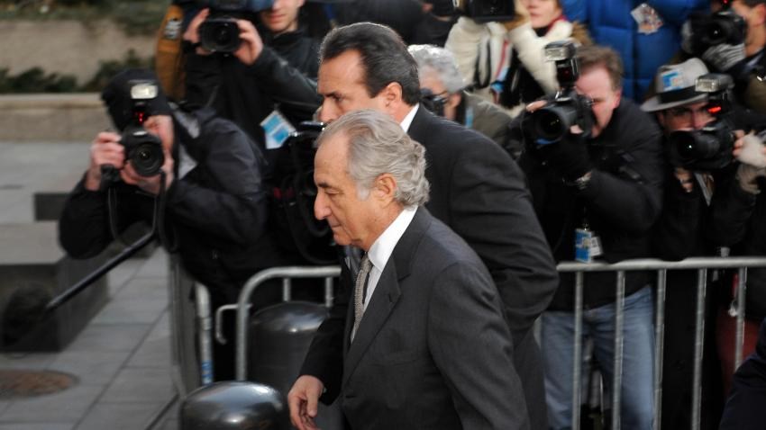 Disgraced Wall Street financier Bernard Madoff (C) arrives at a US Federal Court on March 12, 2009 in New York.