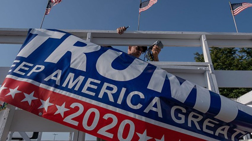 FILE PHOTO: A Trump supporter takes flags off of a wagon after celebrating his nomination and hope for his re-election in Saginaw, Michigan August 27, 2020.