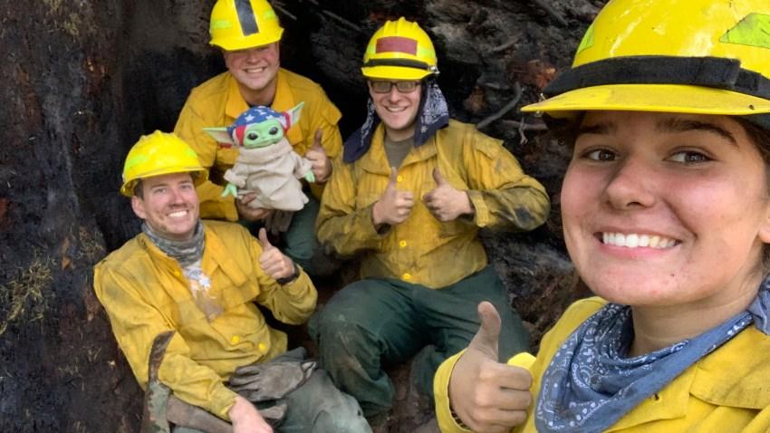 Lucas Galloway, from left, Jaebyn Drake, Rhett Schieder and Audrey Wilcox pose for a selfie with Baby Yoda