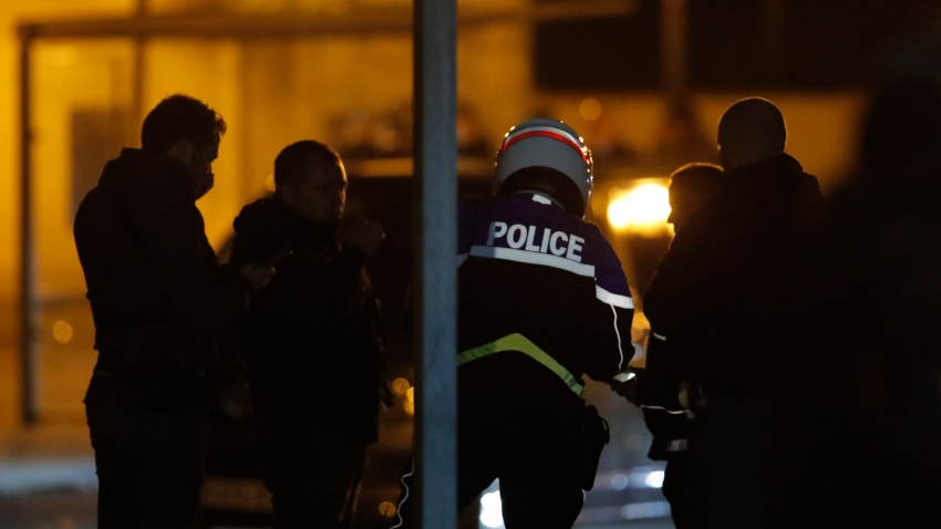 French police officers gather outside a high school after a history teacher who opened a discussion with students on caricatures of Islam's Prophet Muhammad was beheaded, Friday, Oct. 16, 2020 in Conflans-Saint-Honorine, north of Paris. Police have shot the suspected killer dead.