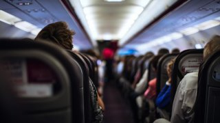 Stock photo of the interior of an airplane taken in Paris, France.