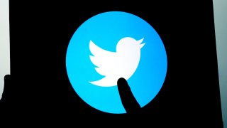 FILE - In this photo illustration, Twitter logos are displayed on a tablet screen, in Ankara, Turkey, Aug. 19, 2020.