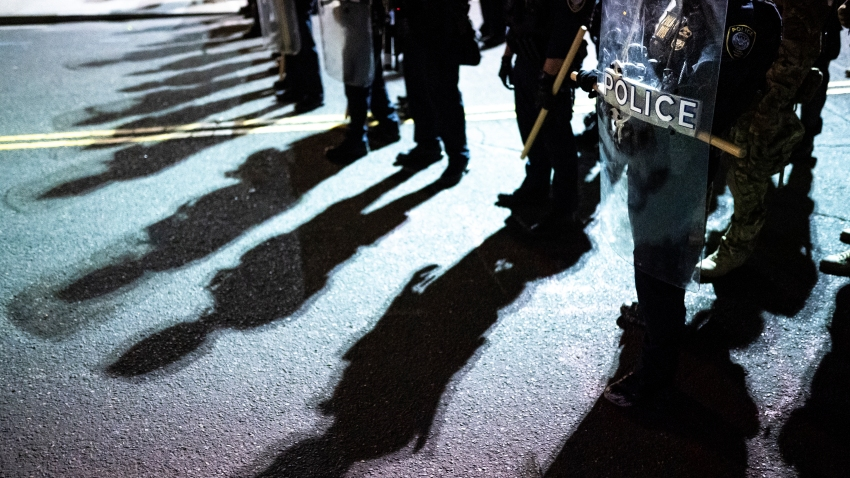 Federal officers line up prior to a crowd dispersal