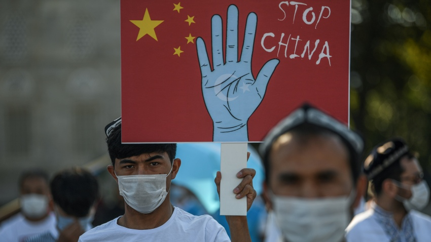 Supporters of China's Muslim Uighur minority wave flags of East Turkestan and hold placards as they gather at the Beyazid square on October 1, 2020 during a demonstration to protest China's Uighur treatment in Istanbul.