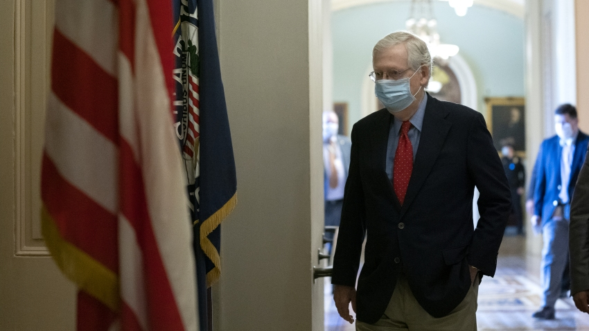 Senate Majority Leader Mitch McConnell, a Republican from Kentucky, wears a protective mask while walking to his office from the Senate Floor at the U.S. Capitol in Washington, D.C., U.S. on Tuesday, Oct. 6, 2020. House Speaker Pelosi and Treasury Secretary Mnuchin will resume negotiations today on another round of pandemic relief for the U.S. economy yet theres still no clear path to a deal before Election Day.