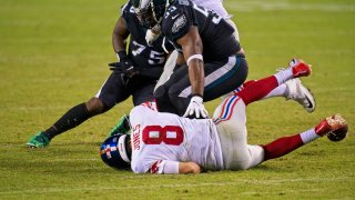 Giants quarterback Daniel Jones on ground after being sacked