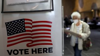 A voter walks towards a booth to fill out her ballot during the in-person early voting at a polling station in Lincoln Center in New York, the United States, Oct. 24, 2020. Early voting began across New York State on Saturday, offering voters nine days to cast their ballots prior to Election Day.