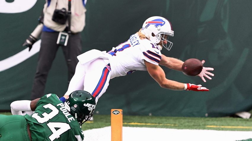 Cole Beasley #11 of the Buffalo Bills tries for the catch but couldn't re-establish control of the ball in-bounds