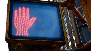 Crosswalk sign showing don't walk signal