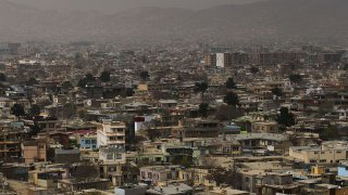 In this file photo, houses stand for miles in the cityscape of Kabul.
