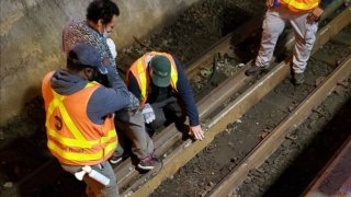 Man stuck on tracks helped by LIRR workers