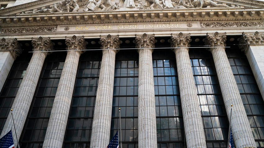 American flags fly on the front of the New York Stock Exchange building, Oct. 7, 2020, in New York City.