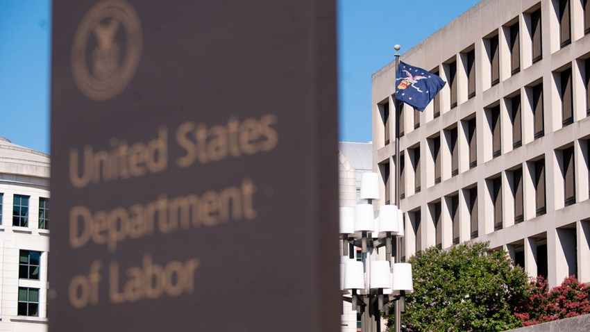 A flag flies outside the U.S. Department of Labor building in Washington, D.C., Aug. 18, 2020.