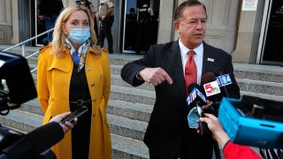 Mark McCloskey addresses the press alongside his wife Patricia, Oct. 6, 2020, outside the Carnahan Courthouse in St. Louis, Mo.