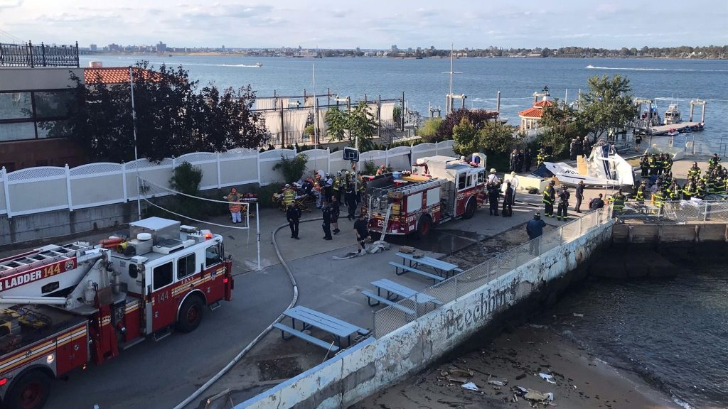 Emergency teams respond to a small plane crash on Queens Pier