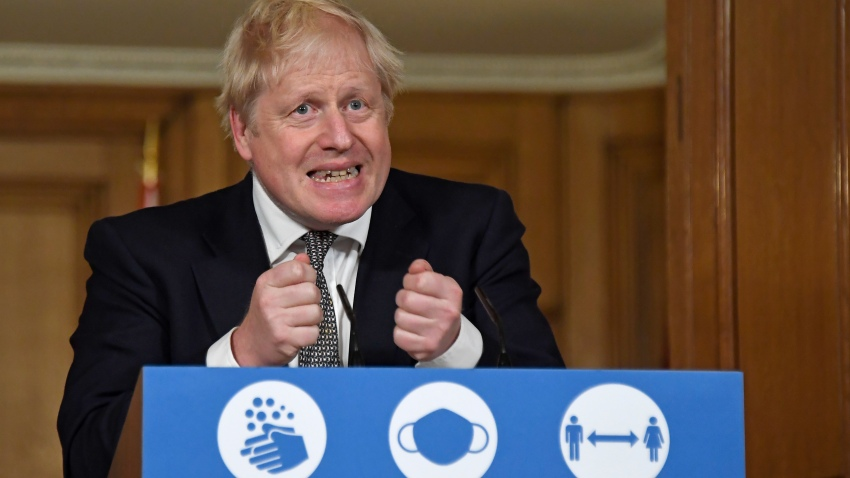 Britain's Prime Minister Boris Johnson gestures as he speaks during a press conference in 10 Downing Street, London