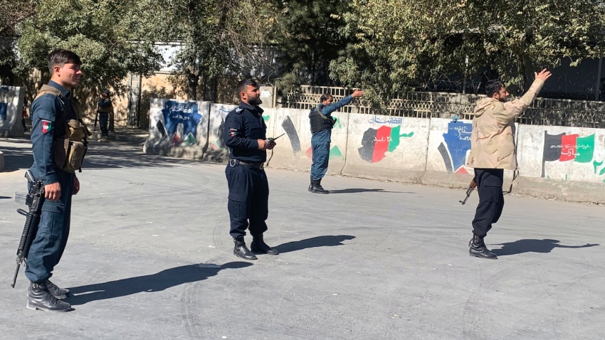 Afghan police arrive at the site of an attack at Kabul University in Kabul, Afghanistan