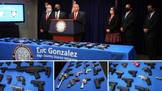 Members of the Brooklyn District Attorney's Office with firearms confiscated from a gun trafficking ring