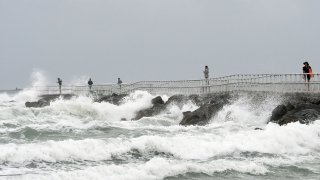 In this file photo, waves crash on the jetty at Lighthouse Point Park as Tropical Storm Isaias travels up the Atlantic coast on August 2, 2020 in Ponce Inlet, Florida. After weakening from a Category 1 hurricane, Isaias continued to bring rain and gusty winds to coastal Florida, causing beach erosion and power outages to thousands of homes.