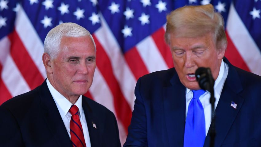 US Vice President Mike Pence (L) listens as US President Donald Trump speaks during election night in the East Room of the White House in Washington, DC, early on November 4, 2020.
