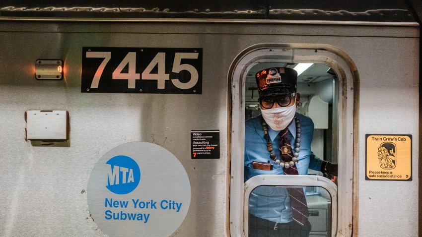 MTA subway conductor sticks his head out of the train window