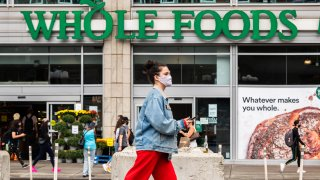 A person wears a face mask outside Whole Foods Market in Union Square
