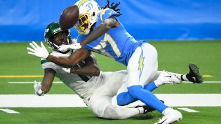 Tevaughn Campbell #37 of the Los Angeles Chargers breaks up a catch to Denzel Mims #11 of the New York Jets