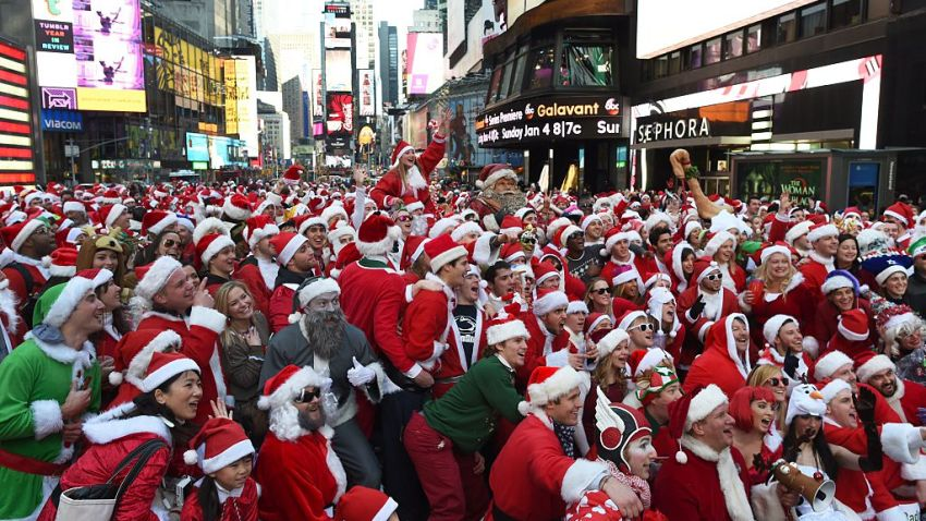 People dressed as Santa Claus and Mrs. Claus participate in SantaCon