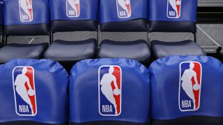 NBA logo on seats in an arena