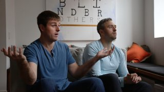 In this Oct. 23, 2020, file photo, brothers, Bryan, left, and Bradford Manning, discuss the origins of their clothing company, Two Blind Brothers, in their New York City loft. The brothers who've lost much of their vision to a rare degenerative eye disorder began their company in 2016 and have donated all profits, more than $700,000, to preclinical research trials to help cure blindness.