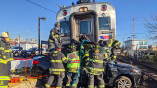 Firefighters responded to a collision between a NJ Transit line and passenger vehicle.