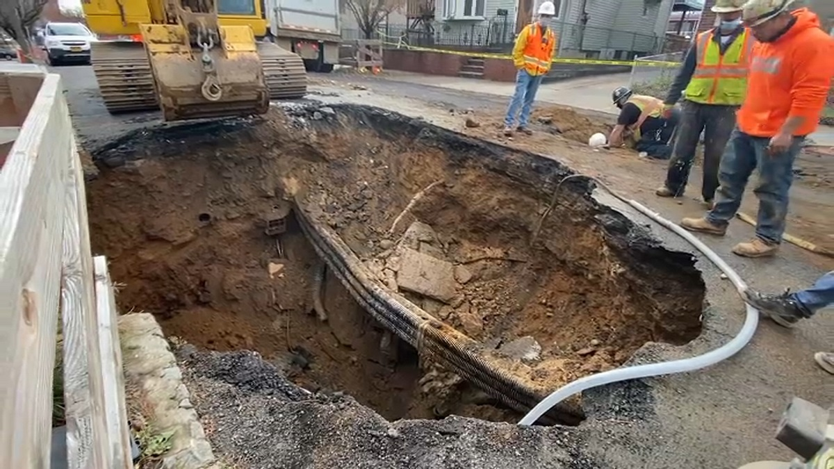 Massive Sinkhole Opens Up On Queens Street  Swallows Suv
