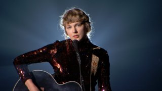 In this Sept. 16, 2020, file photo, Taylor Swift performs onstage during the 55th Academy of Country Music Awards at the Grand Ole Opry in Nashville, Tennessee.