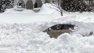 This photo, provided by the New York State Police, shows a car, in Owego, NY, from which a New York State Police sergeant rescued Kevin Kresen, 58, of Candor, NY, stranded for 10 hours, covered by nearly 4 feet of snow