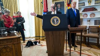 Former wrestler Dan Gable speaks before being presented the Presidential Medal of Freedom award from U.S. President Donald Trump, right, during a ceremony in the Oval Office of the White House in Washington, D.C., on Monday, Dec. 7, 2020.