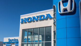 Honda Motor Co. Logo and Sign. Honda Manufactures Among the Most Reliable Cars in the World VI