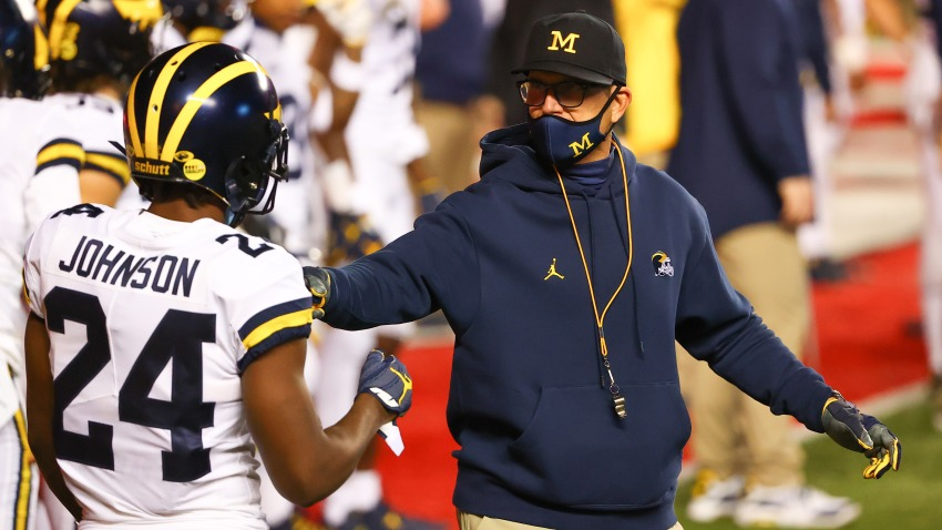 PISCATAWAY, NJ - NOVEMBER 21: Michigan Wolverines head coach Jim Harbaugh talks with Michigan Wolverines defensive back George Johnson (24) during warm up prior to the college football game between the Rutgers Scarlet Knights and the Michigan Wolverines on November 21, 2020 at SHI Stadium in Piscataway, NJ.