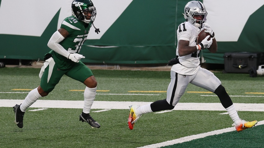 Henry Ruggs III #11 of the Las Vegas Raiders scores a touchdown to win the game