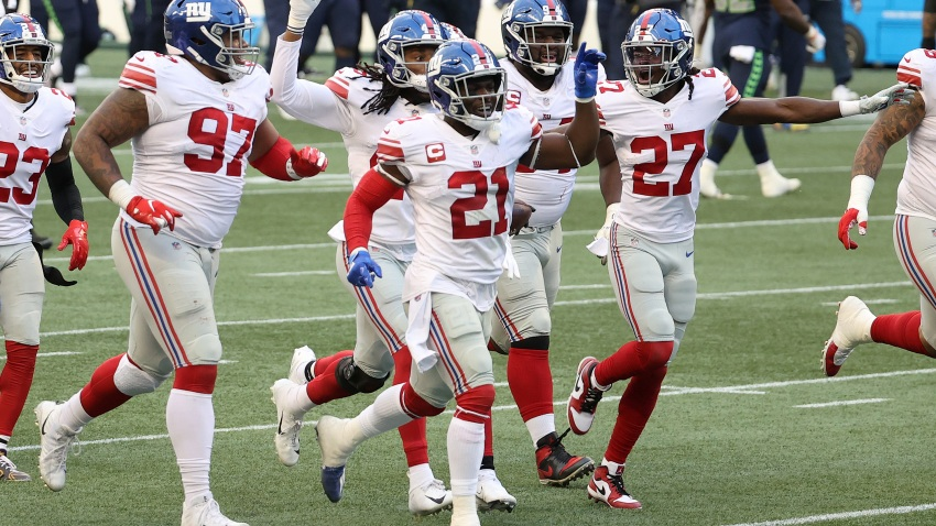 Dexter Lawrence #97, Jabrill Peppers #21 and Isaac Yiadom #27 of the New York Giants celebrate an interception