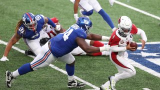 Defensive tackle Dalvin Tomlinson #94 of the New York Giants tackles quarterback Kyler Murray #1 of the Arizona Cardinals for a sack