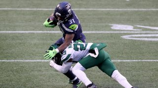 Arthur Maulet #23 of the New York Jets tackles DeeJay Dallas #31 of the Seattle Seahawks during the fourth quarter