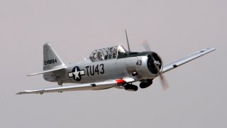 """A restored the WWII Tuskegee Airmen AT 6 Texan, """"Double Vee"""" airplane will be at the Van Nuys Airshow, """"Rockin' Airfest 2006""""."""