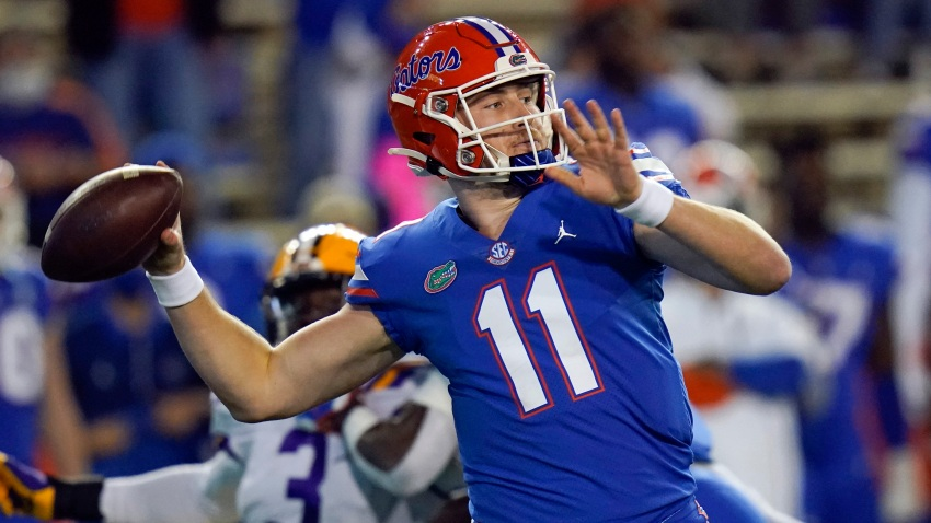 In this Dec. 12, 2020, file photo, Florida quarterback Kyle Trask (11) throws a pass against LSU during the first half of an NCAA college football game in Gainesville, Florida. Trask has been named a finalist for the Heisman Trophy. The Heisman will be awarded Jan. 5 during a virtual ceremony as the pandemic forced the cancellation of the usual trip to New York that for the presentation that usually comes with being a finalist.