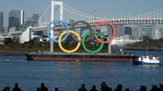 In this Dec. 1, 2020, file photo, the Olympic Symbol is reinstalled after it was taken down for maintenance ahead of the postponed Tokyo Olympics in the Odaiba section in Tokyo.