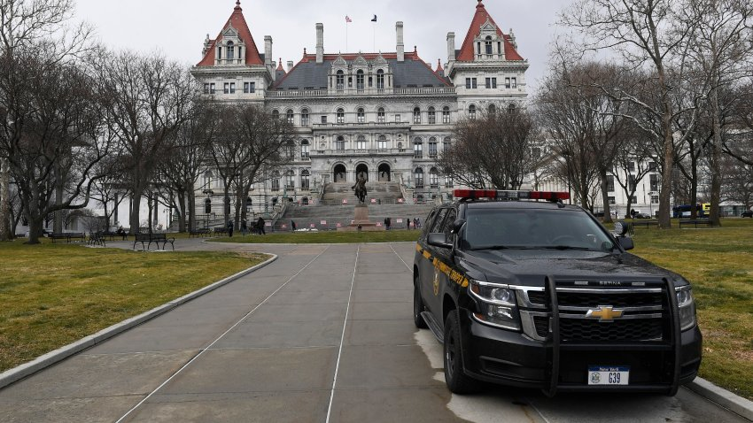 New York State Police patrol the grounds of the state Capitol