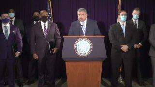 Brooklyn District Attorney Eric Gonzalez, center.